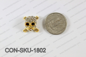 Sideway Skull connector gold 16x18mm CON-SKU-1802