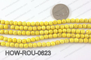 howlite round facted 48 cut yellow 6mm HOW-ROU-0623